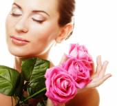 Woman with pink roses — Stock Photo