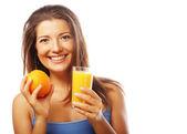 Young happy woman drinking orange juice — Стоковое фото