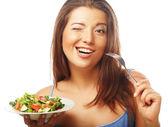 Happy woman eating salad — Stock Photo