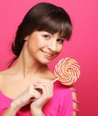 Pretty woman with lollipop — Stock Photo