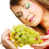 Young woman with bunch of grape. — Stock Photo