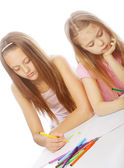 Sisters draw on the album — Stock Photo