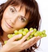 Woman with green grapes — Stock Photo