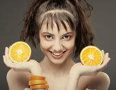 Womans face with juicy orange — Stock Photo