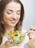 Smiling girl with a salad — Stock Photo