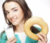 Woman with milk and donut — Stock Photo