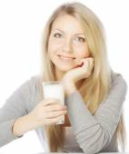 Young woman holding a glass of fresh milk — Stock Photo