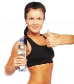 Donna sportiva con bottiglia d'acqua — Foto Stock
