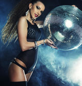 Dancer girl in smoke with disco ball — Stock Photo
