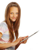 Girl working with the portable tablet computer — Stock Photo