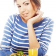Young woman has breakfast salad from fresh vegetables with oran — Stock Photo #55630437