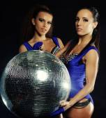 Young dancer girls in smoke with disco ball — Stock Photo