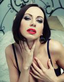 Striptease dancer on bed. — Stock Photo