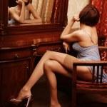 Sexy brunette posing next to the mirror — Stock Photo #59239081