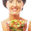 Young funny woman eating salad — Stock Photo #59365401