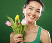 Happy asian girl with  tulips — Stock Photo