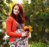 Pregnant woman walking in autumn park — Stock Photo