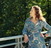 Woman on bridge in autumn park — Foto de Stock