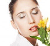 Woman with yellow flower — Stock Photo