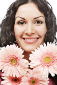 Attractive young woman face with flowers — Stock Photo