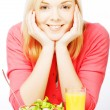 Young woman has breakfast salad from fresh vegetables with oran — Stock Photo #62515455