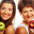 Middle age woman with her daughter holding apples — Stock Photo #62852963