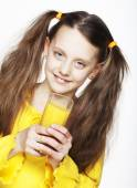 Portrait of girl drinking orange juice — Stock Photo