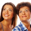 Mother and adult daughter looking up — Stock Photo #68323899