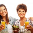 Two women with juice and salad — Stock Photo #68323945