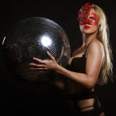 Lady in mask with disco ball — Stock Photo