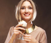 Young woman holding cafe latte cup — Stock Photo