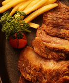 Rustic beefsteak with french fries — Стоковое фото