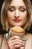 Smiling young woman with a cake — Stock Photo