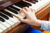 Closeup of child's hand palying piano — Zdjęcie stockowe