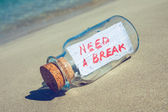 "Bottle with a message ""need a break"". Stress and vacation concept. — Stock Photo"