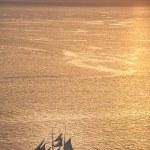 Ship at sunset in Oia, Santorini, Greece — Stock Photo #60991469