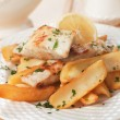 Cod fish steak with fried potato and lemon — Stock Photo #59526361