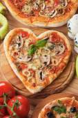 Heart shaped funghi pizza — Stock Photo