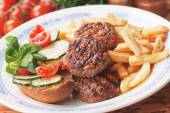 Mini burgers and french fries — Stock Photo