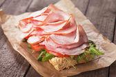 Submarine sandwich with smoked ham — Stock Photo
