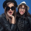 Two girl posing in photo boot — Stock Photo #78254978