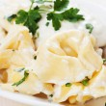 Tortellini pasta in cheese sauce — Stock Photo #78280176