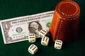 Dice cup dollar — Stock Photo