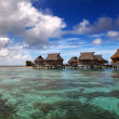 Lodges over transparent quiet sea water- tropical paradise, Maldives — Stock Photo #57478957