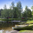Boats on the bank of the forest lake — Foto Stock #65156301