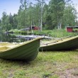 Boats on the bank of the forest lake — Foto Stock #65156349