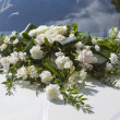 Wedding bouquet on a cowl of the white car — Stock Photo #69735763