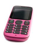 Old push-button pink telephone — Stock Photo