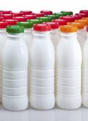 Dairy products bottles with bright covers — Foto Stock