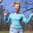 The woman jumps  in the early spring wood — Stock Photo #73461691